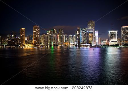 Miami skyline skyscrapers at the night yacht or boat next to Miami downtown Aerial view south beach