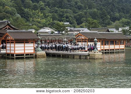 Miyajima, Japan - September 14 2017: Student Children In Uniform On Pier Of Itsukushima Shrine