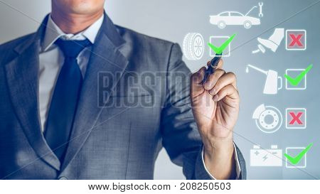 Businessman is checking a hologram to list about the secure of car Safety drive background. checking concept about oil vehicle break battery dis-break