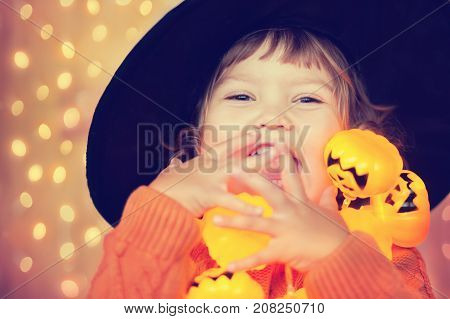 Little Happy Kid With Halloween Decorations, Beautiful Lightings.
