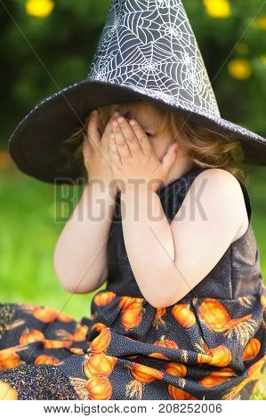 Little Girl Witch In Black Pointed Hat, Afraid Of Halloween