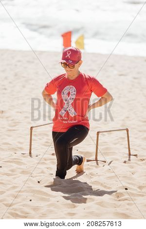 Cabedelo, Paraiba, Brazil - October 7, 2017 - Woman on the beach in functional circuit training