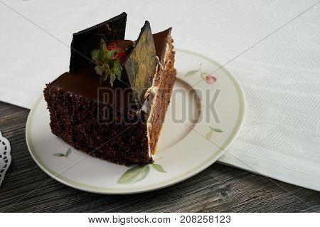Slice Of Chocolate Cake With Fresh Strawberry