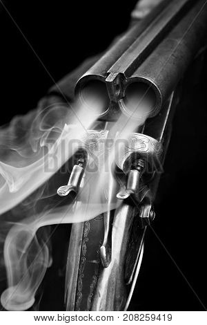 Smoke From A Hunting Double Barrel Vintage Shotgun After Firing.comcept Hunting.closeup.black And Wh