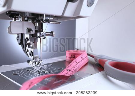 Sewing machine close up. Sewing machine foot and sewing accessories.