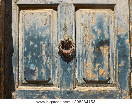 Antique Blue Door With A Rusty Metal Ring Knob Background.