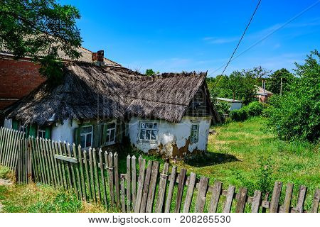 Old country house with reed thatch in a far away village