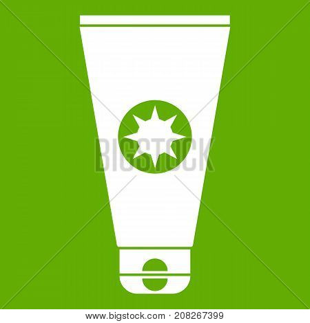 Tube with sunbathing cream icon white isolated on green background. Vector illustration