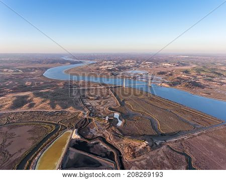 Aerial. Textured fields of swampy salt lakes. Salines of Portugal. Vila Real Santo Antonio.