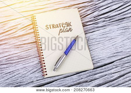 Strategic Plan Word On A Notepad Wooden Background.