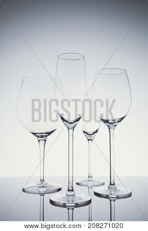 Glassware Selection With Wine, Champagne And Liquour Glasses  On The Light Background
