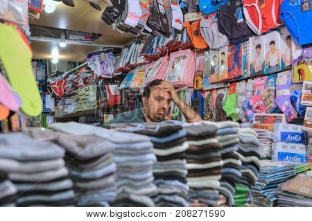 Fars Province Shiraz Iran - 19 april 2017: Shop underwear inside the bazaar one unidentified Iranian salesman bored waiting for buyers.