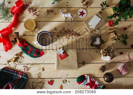 Decorating A Christmas Present, Surrounded By Festive Decorative Items
