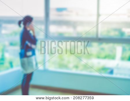 Blurred background woman talk on phone at condominium room.