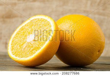 Sliced Navel orange fruit on wooden background