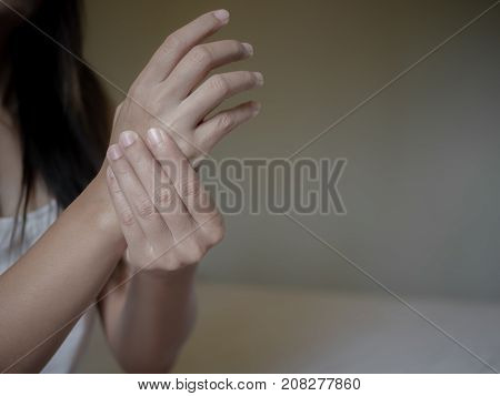 Closeup Young Woman With Painful Hand. Health Care Concept.