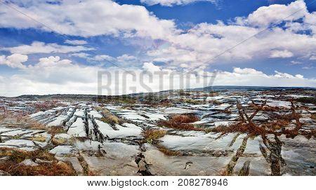 Landscape with shiny rocky fields in Ireland
