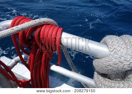 Ship tackle ropes tied to deck railings used for firing and docking at wharf