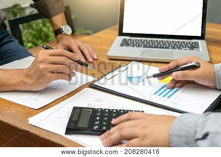 Businessman And Staff Working With Computer On Wood Table With White Computer