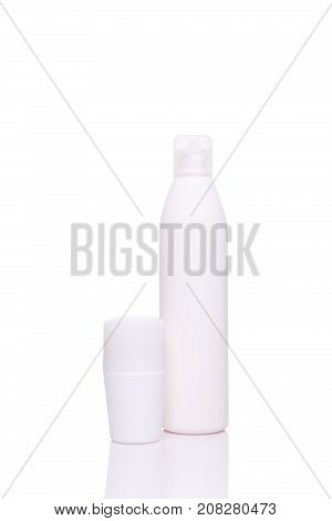 Variety Of White Skincare Or Haircare Bottles Isolated On White