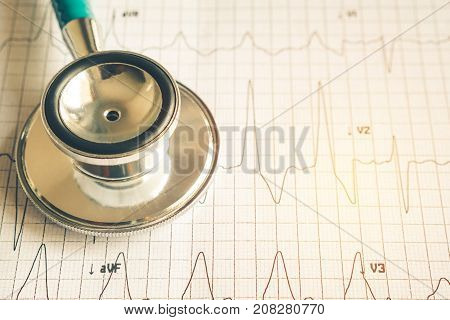 Healthy concept Stethoscope on heart beat wave paper