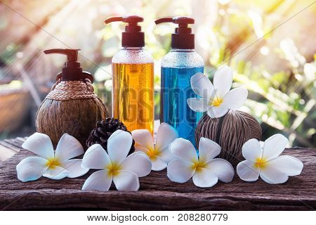 Body care productshower and shampoo with plumeria flower on nature background