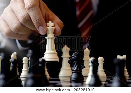 Businessman Play Chess Use King Chess Piece White To Crash Overthrow