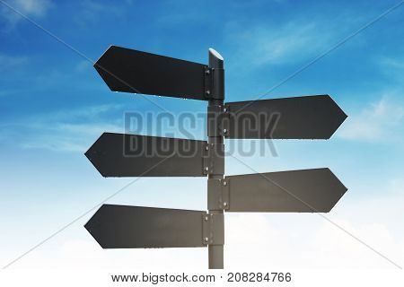 Blank street signpost, on blue sky and white clouds background