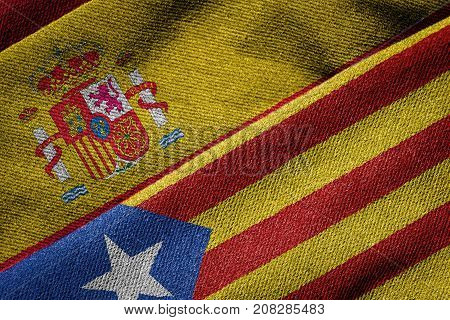 3D rendering of the flags of Spain and Catalonia on woven fabric texture. Detailed textile pattern and grunge theme. Concept of separatist referendum.
