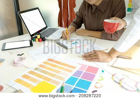 Young Fashion Designer Work With Fabric Cloth