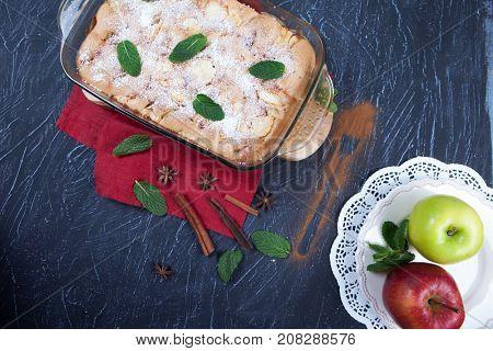 Apple pie in dark rustic background