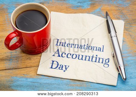 International Accounting Day - handwriting on a napkin with a cup of coffee