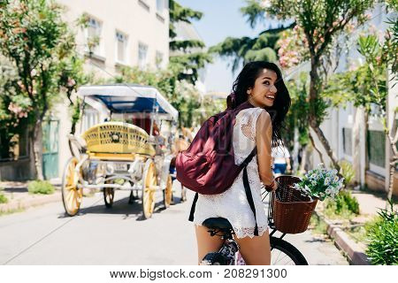 Girl sitting on bicycle, phaeton near,tropical summer sport,vintage