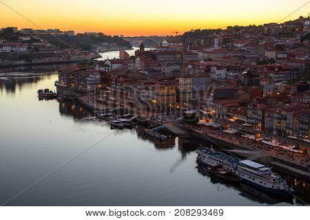 Douro river and Ribeira from Dom Luis I bridge in twilight, Porto, Portugal.