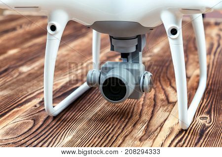 white drone isolated on a wooden background