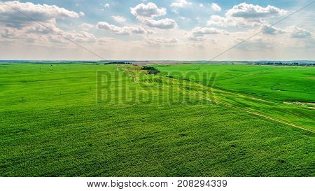 House in a field in the background of mountains