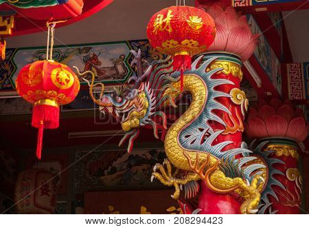 Golden dragon statue in  old chinese temple, Mae Sot, Tak Province,  western Thailand.