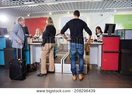 Passengers Weighting Their Luggage At Airport