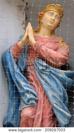 VARAZDIN, CROATIA - JULY 09: Virgin Mary statue on house facade in Varazdin, Croatia on July 09, 2016.
