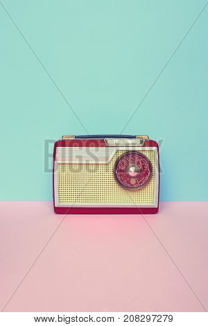 Vintage old radio on pastel background with space for copy.