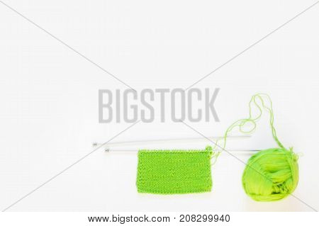 Knitted Knitted Green. Yarn For Knitting Green. White Background.