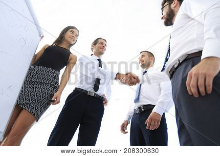 handshake business colleagues after discussing the new presentation.