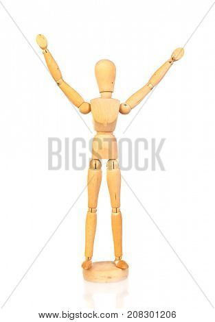 Wooden articulated doll raising the arms on the white isolated background