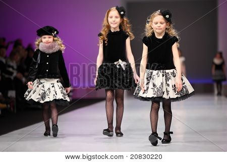 MOSCOW - FEBRUARY 22: Three unidentified child models wear fashions from Snowimage and walk the catwalk in the Collection Premiere Moscow,  an international fashion fair for Eastern Europe, on February 22, 2011 in Moscow, Russia.