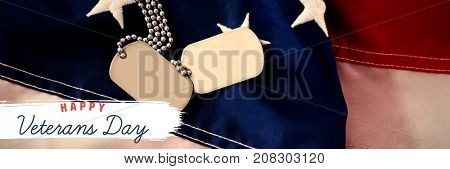 Logo for veterans day in america  against high angle view of dog tag chains on american flag