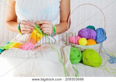 Close-up Of Woman Hands Knitting Colorful Wool Yarn. Close-up Horizontal Photo. Freelance Creative W