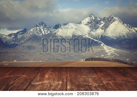 Table on winter mountains background