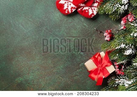 Xmas greeting card. Christmas background with snow fir tree and gift box. View from above with space for your greetings