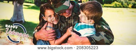 Logo for veterans day in america  against happy soldier reunited with his son and daughter