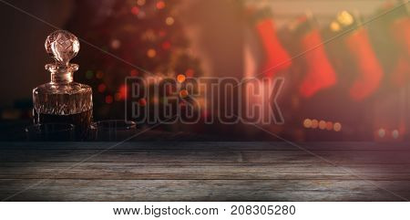 Close-up of plank against wooden chair with red pillow and santa hat